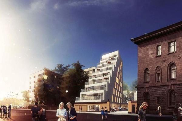En visionsbild av ett höghus i åtta etage.