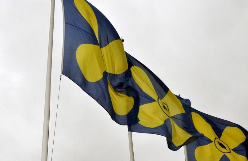 tre flaggor i rad