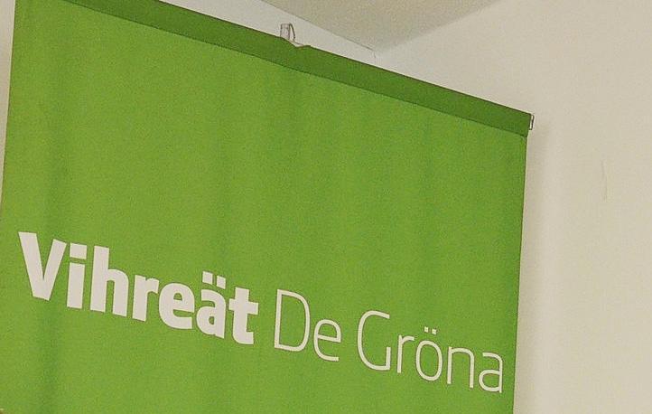 Grönt plakat med texten Vihreät De Gröna