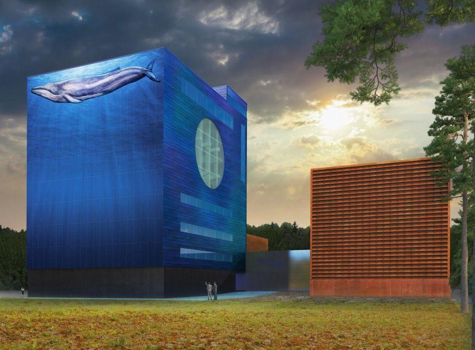 En stor byggnad som målats blå med en val.