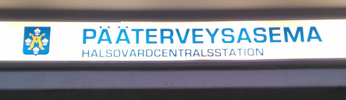 en neonskylt för Åbo stads hälsovård