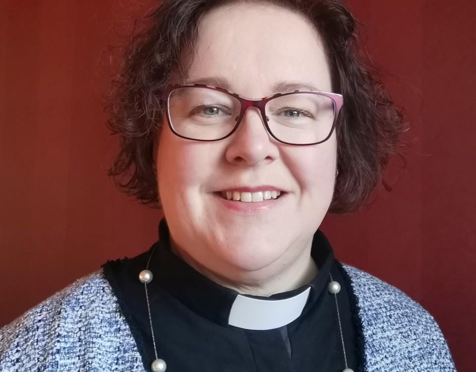 en kvinnlig präst