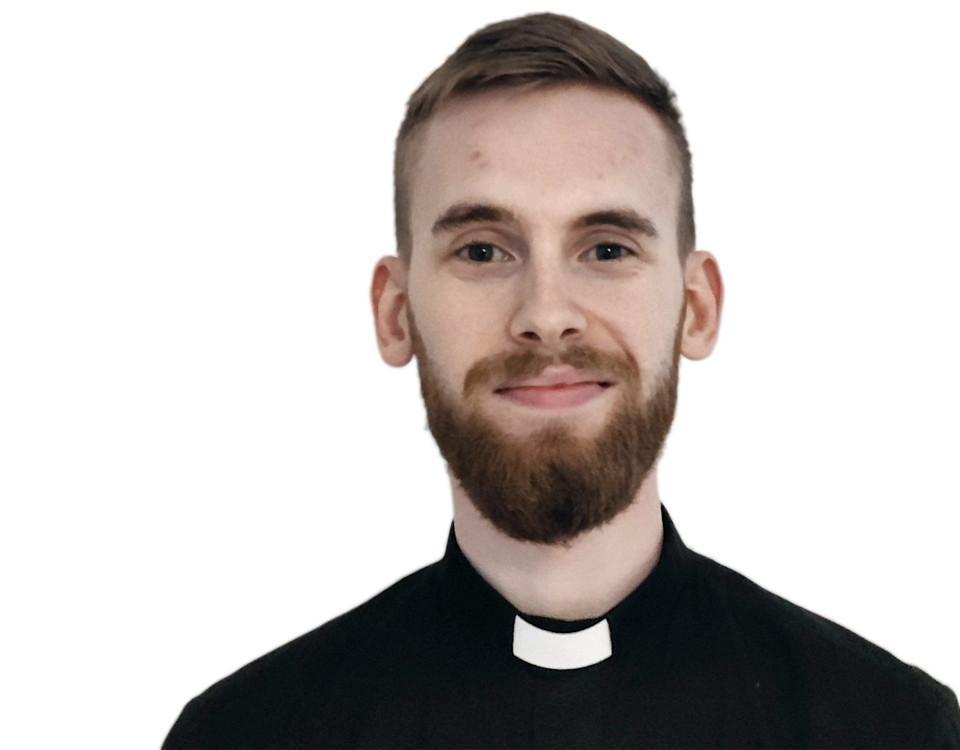 ung man i prästklädsel